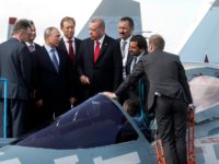 Russian President Vladimir Putin (3rd R) and his Turkish counterpart Recep Tayyip Erdogan (4th L) inspect Sukhoi Su-57 fifth-generation fighter during the MAKS-2019 International Aviation and Space Salon opening ceremony in Zhukovsky outside Moscow on August 27, 2019. (Photo by Maxim SHIPENKOV / POOL / AFP) (Photo credit should read …
