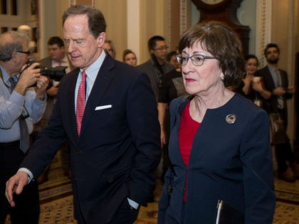 WASHINGTON, DC - JANUARY 24: Sen. Patrick Toomey (R-PA), left, and Sen. Susan Collins (R-ME), right, walk to the Senate Chamber on Capitol Hill, January 24, 2019 at the U.S. Capitol in Washington, DC. The Senate has failed to pass two procedural votes, one proposed by Republicans and the other …
