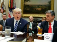 President Donald Trump, flanked by Sen. Heidi Heitkamp, D-N.D., left, and Sen. Joe Manchin, D-W.Va., speaks during a meeting with Senators on his Supreme Court Justice nominee Neil Gorsuch, Thursday, Feb. 9, 2017, in the Roosevelt Room of the White House in Washington. (AP Photo/Evan Vucci)