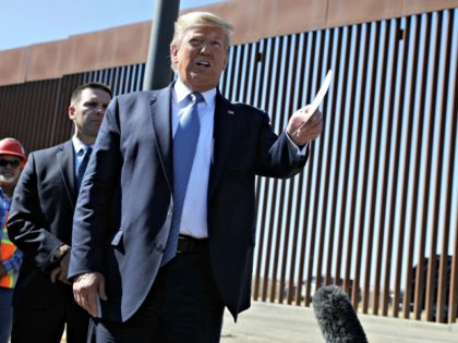 President Donald Trump talks with reporters as he tours a section of the southern border wall, Wednesday, Sept. 18, 2019, in Otay Mesa, Calif. (AP Photo/Evan Vucci) ORG XMIT: CAEV426 (Photo: Evan Vucci, AP)