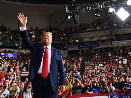"US President Donald Trump waves to his supporters after a ""Keep America Great"" campaign rally at the SNHU Arena in Manchester, New Hampshire, on August 15, 2019. (Photo by Nicholas Kamm / AFP) (Photo credit should read NICHOLAS KAMM/AFP/Getty Images)"