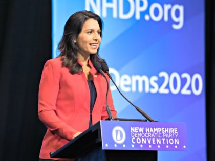 MANCHESTER, NH - SEPTEMBER 07: Democratic presidential candidate Rep. Tulsi Gabbard (D-HI) speaks during the New Hampshire Democratic Party Convention at the SNHU Arena on September 7, 2019 in Manchester, New Hampshire. Nineteen presidential candidates will be attending the New Hampshire Democratic Party convention for the state's first cattle call …