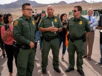 Customs and Border Protection officers give the media a tour of the new temporary migrant tent facility in El Paso, Texas, on May 2, 2019. - The facility is meant to address the record number of families and children apprehended crossing the US-Mexico border, and has shower, laundry and medical …