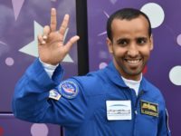 Member of the main crew to the International Space Station (ISS) United Arab Emirates' astronaut Hazza Al Mansouri waves to people as he leaves his hotel for a pre-launch preparation at the Russian-leased Baikonur cosmodrome in Kazakhstan on September 25, 2019. - Al Mansouri will make history by becoming the …