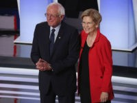 DETROIT, MICHIGAN - JULY 30: Democratic presidential candidates Sen. Bernie Sanders (I-VT) and Sen. Elizabeth Warren (D-MA) take the stage at the beginning of the Democratic Presidential Debate at the Fox Theatre July 30, 2019 in Detroit, Michigan. 20 Democratic presidential candidates were split into two groups of 10 to …