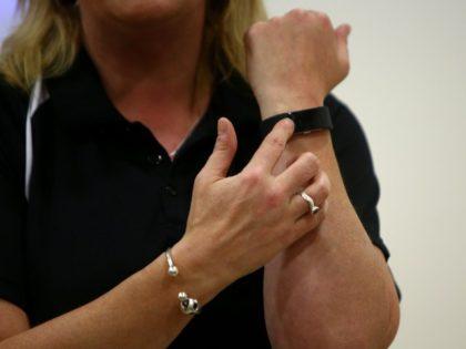 Woman wearing a Fitbit