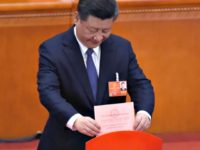 Xi-Jinping-casts-vote-to end term limits