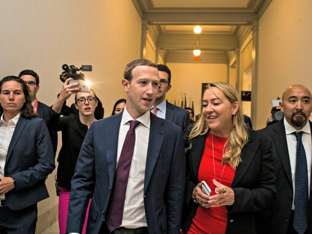 WASHINGTON, DC - SEPTEMBER 19: Facebook CEO Mark Zuckerberg walks to a meeting with Sen. Josh Hawley (R-MO) on September 19, 2019 in Washington, DC. Zuckerberg also met with Sen. Maria Cantwell (D-WA) and Sen. Mike Lee (R-UT) to discuss internet regulation. (Photo by Zach Gibson/Getty Images)