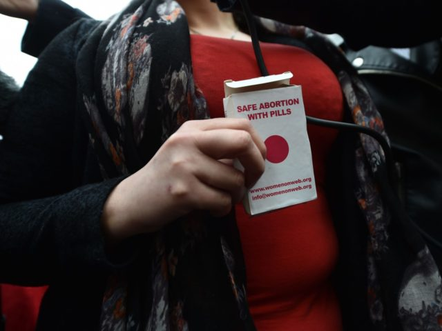 BELFAST, NORTHERN IRELAND - MAY 31: An unindentified woman displays an abortion pill packet after taking one of the pills as abortion rights campaign group ROSA, Reproductive Rights Against Oppression, Sexism and Austerity distribute abortion pills from a touring bus on May 31, 2018 in Belfast, Northern Ireland. Flouting Northern …