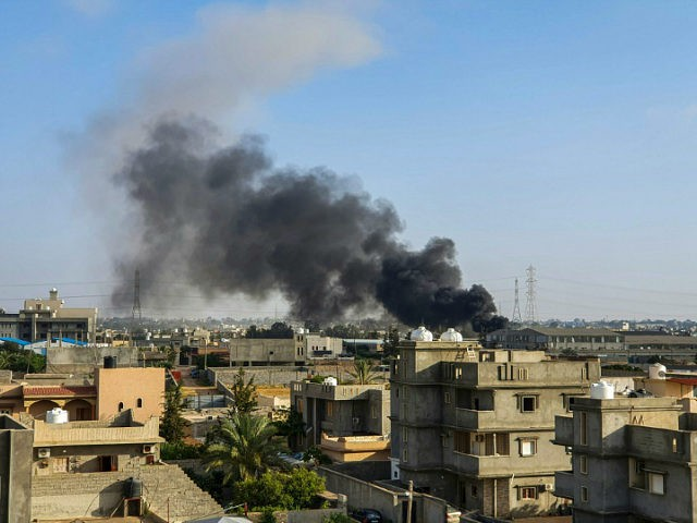 This picture taken on June 29, 2019 shows smoke plumes rising in Tajoura, south of the Libyan capital Tripoli, following a reported airstrike by forces loyal to retired general Khalifa Haftar. (Photo by Mahmud TURKIA / AFP) (Photo credit should read MAHMUD TURKIA/AFP/Getty Images)