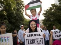 Members of Palestinian comunity in Romania take part in an anti-war and anti-Israel protest in the front of Romanian government headquarters in Bucharest on July 25, 2014. AFP PHOTO DANIEL MIHAILESCU (Photo credit should read DANIEL MIHAILESCU/AFP/Getty Images)