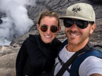 Jolie King and Mark Firkin take a selfie in front of a volcano in Indonesia. Facebook