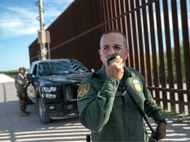PENITAS, TEXAS - SEPTEMBER 10: U.S. Border Patrol agent Carlos Ruiz spots a pair of undocumented immigrants while coordinating with active duty U.S. Army soldiers near the U.S.-Mexico border fence on September 10, 2019 in Penitas, Texas. U.S. military personnel deployed to the border assist U.S. Border Patrol agents with …