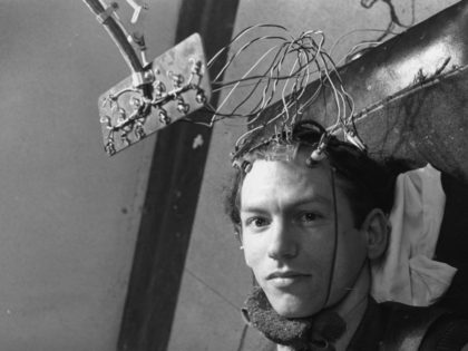 A patient is connected to an encephalogram machine, which will record his brain's activity by reading the rhythmic electric pulses it emits. This takes place in the laboratory of Dr Grey Walter at the Burden Neurological Institute at Bristol University. Original Publication: Picture Post - 4998 - New Light On …