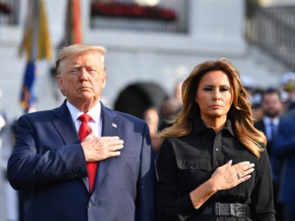US President Donald Trump and First Lady Melania Trump observe a moment of silence at the White House to mark the 18th anniversary of the 9/11 attacks, on September 11, 2019, in Washington, DC. (Photo by Nicholas Kamm / AFP) (Photo credit should read NICHOLAS KAMM/AFP/Getty Images)