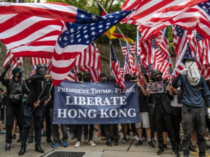 HONG KONG, CHINA - SEPTEMBER 08: Protesters wave U.S flags outside the U.S consulate after delivering a petition on September 8, 2019 in Hong Kong, China. Pro-democracy protesters have continued demonstrations across Hong Kong despite the withdrawal of a controversial extradition bill as demonstrators call for the city's Chief Executive …
