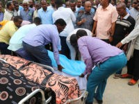 Relatives lay down on July 25, 2019 the dead body of one of Mogadishu district commissioners who was killed in a suicide bomb attack on July 24. - Six people were killed and the mayor of Mogadishu was wounded in a bombing at the mayoral offices in the Somali capital …
