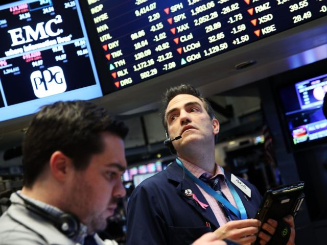NEW YORK, NY - FEBRUARY 02: Traders work on the floor of the New York Stock Exchange (NYSE) on February 2, 2016 in New York City. The Dow Jones industrial average fell nearly 300 points today on renewed fears over the health of the global economy and another fall in …