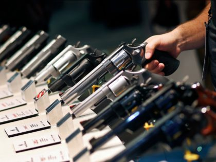 In this Jan. 19, 2016 file photo, handguns are displayed at the Smith & Wesson booth at the Shooting, Hunting and Outdoor Trade Show in Las Vegas. Backers of an expanded gun background check ballot measure approved by Nevada voters in 2016 are arguing that the Nevada governor and attorney …