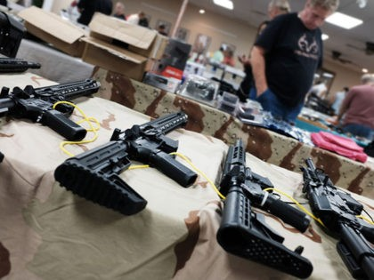 NAPLES, FLORIDA - NOVEMBER 24: Guns stand for sale at a gun show on November 24, 2018 in Naples, Florida. According to recently released data from the U.S. centers for Disease Control and Prevention, suicides and homicides involving guns have been increasing in America. The report, which faced a large …