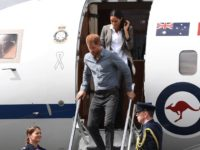 Britain's Prince Harry and his wife Meghan, the Duchess of Sussex disembark from their plane following their arrival in Dubbo on October 17, 2018. - Prince Harry and his expectant wife Meghan visited a drought-stricken region of Australia on October 17, bringing a rare and welcome rainstorm with them. (Photo …