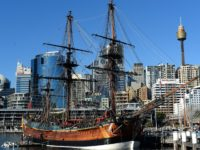 Workers busy in minor repair work of the Australian-built replica of James Cook's HMB Endeavour at the western shore of Sydney's Darling Harbour on July 3, 2013. Australia's central bank gave a strong signal it may continue cutting interest rates to cushion the economy as a long mining boom slows. …