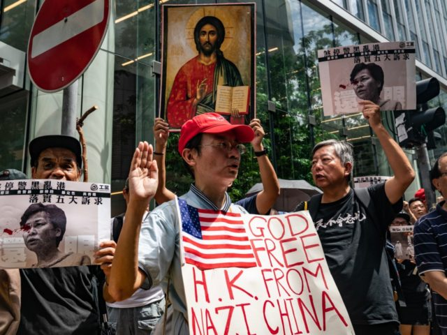 HONG KONG, CHINA - AUGUST 31: Protesters take part in an anti-government rally as they march on a street in Central district on August 31, 2019 in Hong Kong, China. Pro-democracy protesters have continued rallies on the streets of Hong Kong against a controversial extradition bill since 9 June as …
