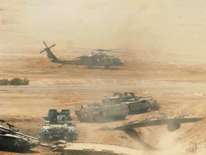 SHIZAFON, ISRAEL - JUNE 05: In this handout photo distributed by the Israel Defense Forces (IDF) helicopters and tanks are mobilized as the Israeli army takes part in a military manoeuvre to conquer a Syrian outpost June 05, 2007 in Shizafon in the southern Israeli, Negev desert. The military exercise …