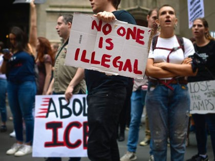 A protestor holds a sign reading No one is Illegal during a rally against the US immigration policy on September 14, 2019 in New York City. - Some dozens protesters were arrested by the police after blocking the 5th Avenue. (Photo by Johannes EISELE / AFP) (Photo credit should read …
