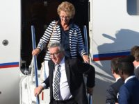 President of the European Commission Jean-Claude Juncker and his wife Christiane Frising step out of their plan upon their arrival at the airport in Hamburg, northern Germany on July 6, 2017 to attend the G20 meeting. Leaders of the world's top economies will gather from July 7 to 8, 2017 …