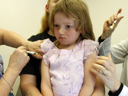 In this April 20, 2012, photo, Holly Ann Haley, 4, gets vaccinations at the doctor's office in Berlin, Vt. Vermont continues to be embroiled in a debate over ending the philosophical exemption that allows parents to have their kids skip the immunizations required for most children to attend school. (AP …