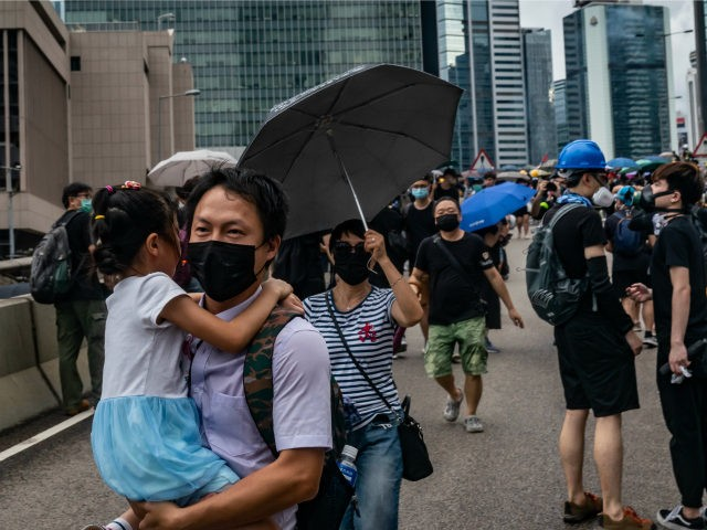 A man carries a girl on a street during an anti-government rally on August 31, 2019 in Hong Kong, China. Pro-democracy protesters have continued rallies on the streets of Hong Kong against a controversial extradition bill since 9 June as the city plunged into crisis after waves of demonstrations and …
