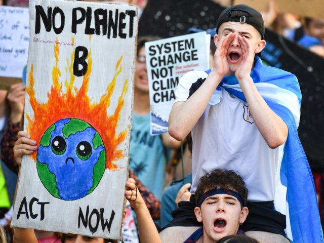 EDINBURGH, SCOTLAND - SEPTEMBER 20: Protesters march and hold placards as they attend the Global Climate Strike on September 20, 2019 in Edinburgh, Scotland. Millions of people are taking to the streets around the world to take part in protests inspired by the teenage Swedish activist Greta Thunberg. Students are …