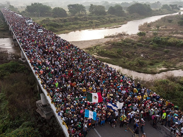 Aerial view of Honduran migrants heading in a caravan to the US, as the leave Arriaga on their way to San Pedro Tapanatepec, in southern Mexico on October 27, 2018. - Mexico on Friday announced it will offer Central American migrants medical care, education for their children and access to …