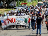 African migrants march to demand humanitarian visas that would enable them to cross Mexico on their way to the US, in Tapachula, Chiapas state, Mexico, in the border with Guatemala, on August 30, 2019. - A policeman, a migrant and two journalists were injured Tuesday during an eviction at a …