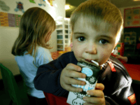 GLASGOW, SCOTLAND - JANUARY 28: A three-year-old boy drinks milk at a private nursery school January 28, 2005 in Glasgow, Scotland. The average price of pre-school care has increased over the past year, sending child care prices to an average of GBP200 in parts of the southeast. Many working parents …