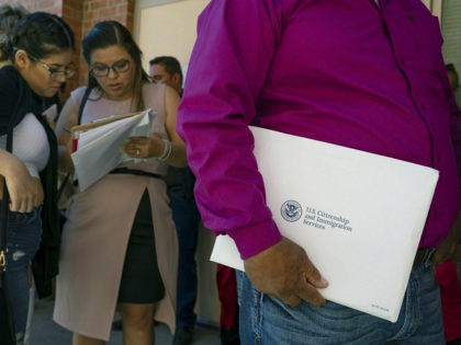 Newly sworn in US citizens wait in line to apply for Social Security cards following a naturalization ceremony at El Paso County Coliseum on April 18, 2019 in El Paso, Texas. - About 740 immigrants from countries throughout the world were sworn in as US citizens. (Photo by Paul Ratje …