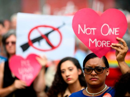 TOPSHOT - Protestors take part in a rally of Moms against gun violence and calling for Federal Background Checks on August 18, 2019 in New York City. (Photo by Johannes EISELE / AFP) (Photo credit should read JOHANNES EISELE/AFP/Getty Images)