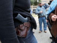 AUSTIN, TX - JANUARY 1: Two women compare handgun holsters during an open carry rally at the Texas State Capitol in Austin, Texas. On January 1, 2016, the open carry law took effect in Texas, and 2nd Amendment activists held an open carry rally at the Texas state capitol on …
