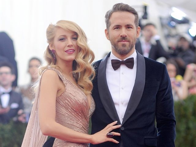"""NEW YORK, NY - MAY 05: Blake Lively and Ryan Reynolds attend the """"Charles James: Beyond Fashion"""" Costume Institute Gala at the Metropolitan Museum of Art on May 5, 2014 in New York City. (Photo by Dimitrios Kambouris/Getty Images)"""