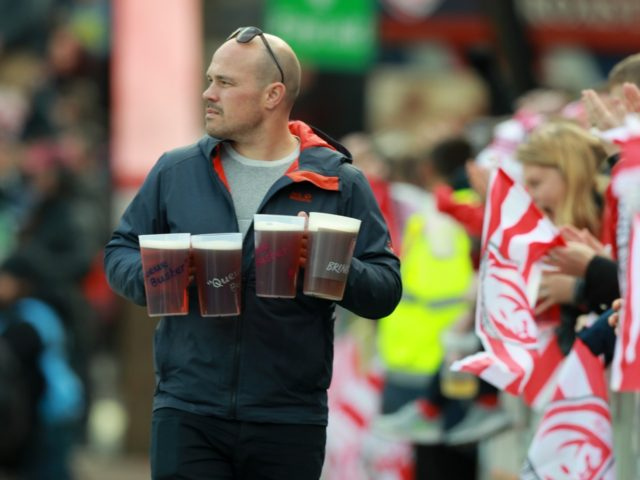 GLOUCESTER, ENGLAND - APRIL 13: A supporter carries beer during the Gallagher Premiership Rugby match between Gloucester Rugby and Bath Rugby at Kingsholm Stadium on April 13, 2019 in Gloucester, United Kingdom. (Photo by David Rogers/Getty Images)