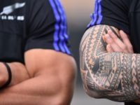 New Zealand All Blacks centre Sonny Bill Williams 's tattoo (R) is pictured during a community coaching event with young players of the London Harlequins in London on September 13, 2015 ahead of the 2015 Rugby Union World Cup. The All Blacks will play against Argentina next September 20 for …