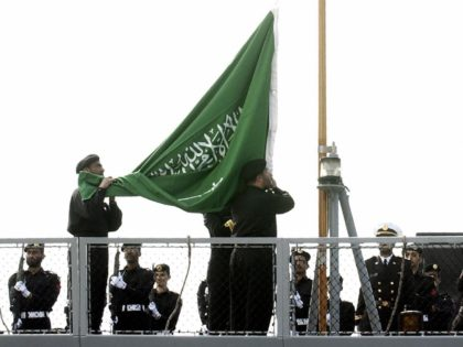 """TOULON, FRANCE: Saudi Navy marines raise the Saudi flag aboard frigate """"Mecca"""", 03 April 2004 in the French Mediterranean port city of Toulon, during a presentation and delivery ceremony for a La Fayette class frigate bought by Riyadh from Paris. The """"Mecca"""" vessel is the second of three La Fayette …"""