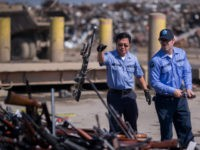 Deputies toss guns onto a pile of approximately 3,500 confiscated weapons to be destroyed at Gerdau Steel Mill under supervision of the Los Angeles County Sheriffs Department and other law enforcement agencies on July 19, 2018 in Rancho Cucamonga, California. The weapons were seized in criminal investigations, probation seizures and …