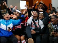 "In this Feb. 16, 2018, photo, University Prep Academy High School students react in Detroit to an announcement that all 600 students will see the film ""Black Panther."" As the film debuts in theaters across the U.S., educators, philanthropist, celebrities, and business owners are pulling together their resources to bring …"
