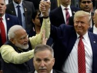 "President Donald Trump and Indian Prime Minister Narendra Modi walk around NRG Stadium waving to the crowd during the ""Howdy Modi: Shared Dreams, Bright Futures"" event, Sunday, Sept. 22, 2019, in Houston. (AP Photo/Evan Vucci)"