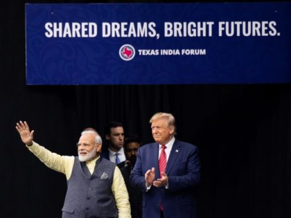 """US President Donald Trump and Indian Prime Minister Narendra Modi attend """"Howdy, Modi!"""" at NRG Stadium in Houston, Texas, September 22, 2019. - Tens of thousands of Indian-Americans converged on Houston on Sunday for an unusual joint rally by Donald Trump and Narendra Modi, a visible symbol of the bond …"""