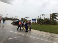 NASSAU, BAHAMAS - SEPTEMBER 03: In this USCG handout image, Guard personnel help medevac a patient in the Bahamas during Hurricane Dorian on September 3, 2019. The massive, slow-moving hurricane which devastated parts of the Bahamas with 110 mph winds and heavy rains is expected to now head northwest and …