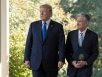 US President Donald Trump -- seen with Fed chief Jerome Powell at the White House in November 2017 -- has repeatedly hit out at the head of the US central bank