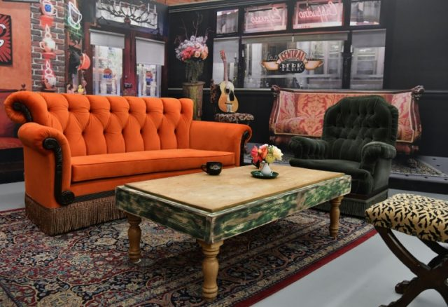 The famous orange sofa where the cast of 'Friends' used to sit in Central Perk. On display as part of an exhibition in New York marking the 25th anniversary of the sitcom